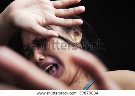 Young woman defending herself, can be used for domestic violence concept - stock photo