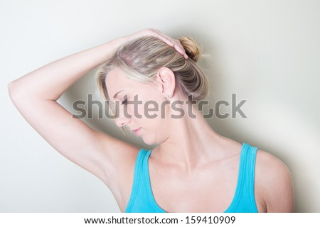 Young woman demonstrating neck muscle exercises in physical therapy - stock photo