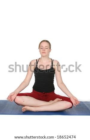 young woman demonstrating yoga lotus pose - stock photo