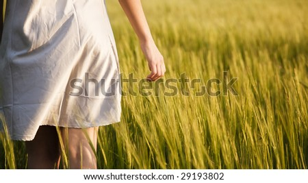 Young woman detail on field - stock photo