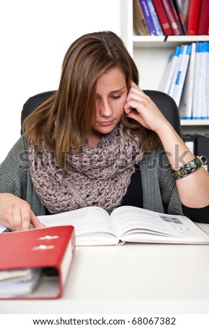 Young woman diligently studying for her exams - stock photo