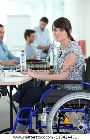 Young woman disabled at work - stock photo