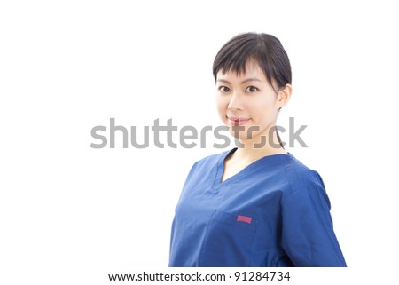 young woman doctor in scrubs isolated on white background - stock photo