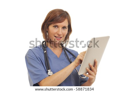 Young woman doctor in scrubs using a touchscreen computer - stock photo