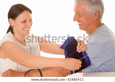 young woman doctor it measures the pressure - stock photo