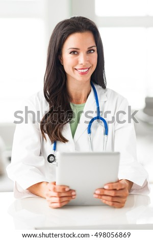 Young Woman Doctor Nurse with Digital Tablet in Clinic
