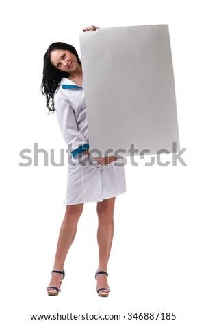Young woman doctor or nurse showing empty blank clipboard sign with copy space for text. - stock photo
