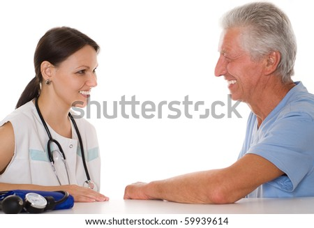 young woman doctor talk with old patient - stock photo