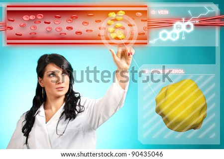Young woman doctor working with modern interface, testing blood and finding cholesterol - stock photo