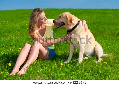 young woman dog meadow spring summer outdoor together - stock photo