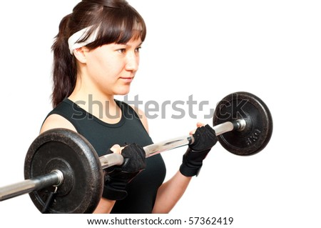 young woman doing a bicep curl isolated on white - stock photo