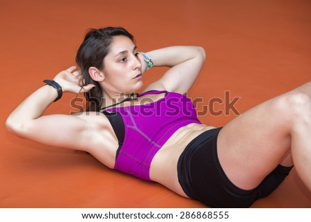 Young woman doing abdominal