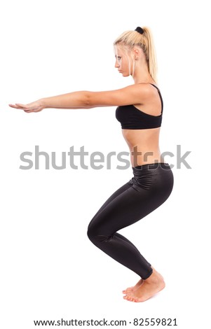 Young woman doing aerobics and stretching, isolated on white background - stock photo