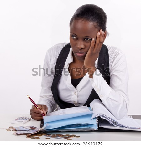 Young woman doing budgets, but looking very tired. - stock photo