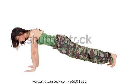 Young woman doing excise(push-up) isolated over white. - stock photo
