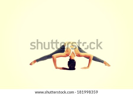 Young woman doing exercise - stock photo