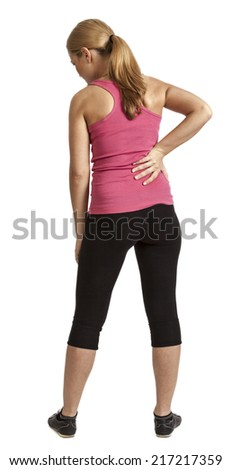 Young woman doing exercise and havin a back pain - isolated against a white background. - stock photo