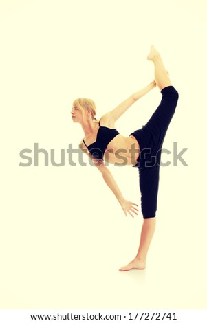 Young woman doing exercise, isolated on white  - stock photo