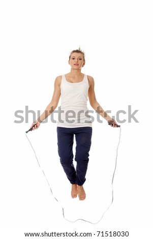 Young woman doing exercise, isolated on white