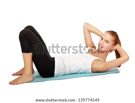 Young woman doing exercise isolated on white background - stock photo