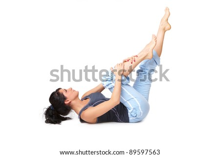 Young woman doing exercise, isolated on white background