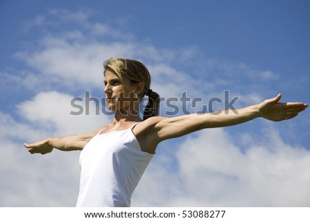 Young woman doing exercise outdoor - stock photo
