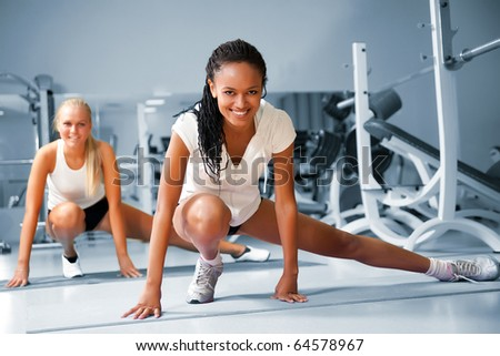 Young woman doing exercises at the fitness club - stock photo