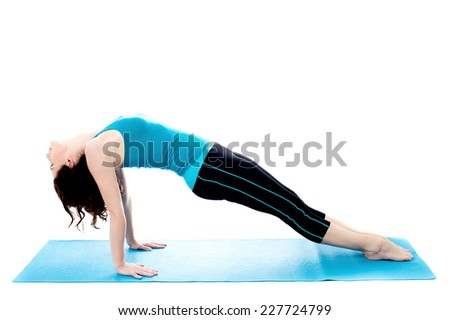 Young woman doing exercises on the mat