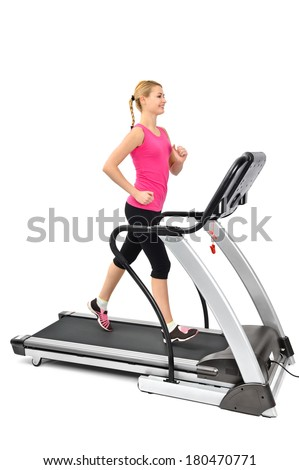 young woman doing exercises on treadmill, isolated, motion blur on moving parts - stock photo