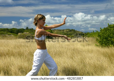 Young woman doing exercises outside