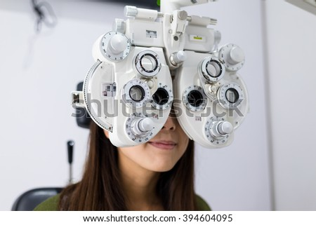 Young Woman doing eyesight test - stock photo