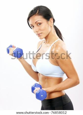 Young Woman doing fitness exercise with a hand weights. - stock photo