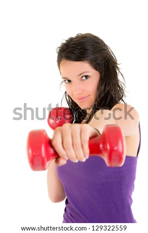 Young Woman doing fitness exercise with hand weights. - stock photo