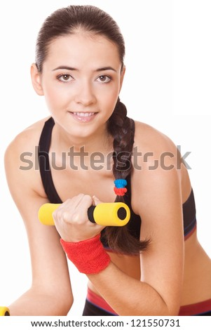 young woman doing fitness exercises for muscle - stock photo