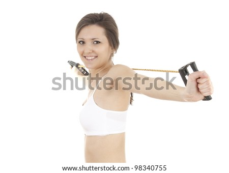young woman doing fitness exercises with expander, white background