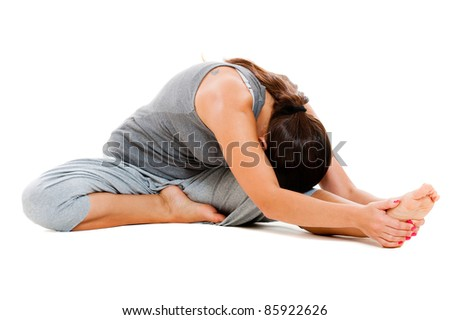 young woman doing flexibility exercise. isolated on white background - stock photo