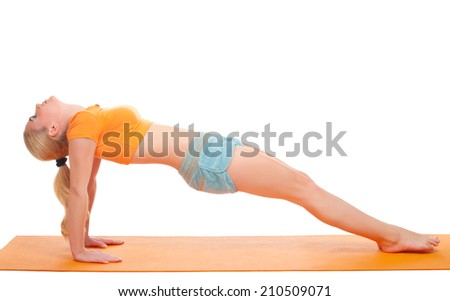 Young woman doing gymnastic exercises isolated - stock photo