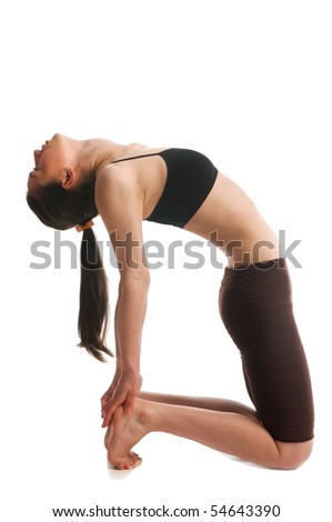 Young woman doing gymnastic on white backgrounds - stock photo