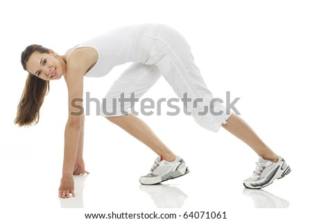 Young woman doing gymnastics