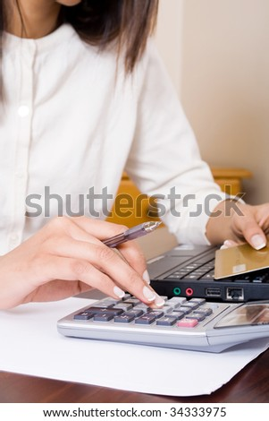 young woman doing home financial calculations - stock photo