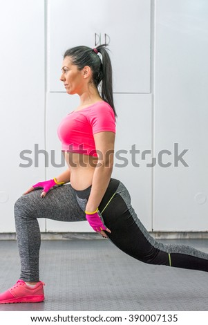 Young woman doing leg workout in the gym