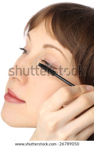 Young woman doing make-up