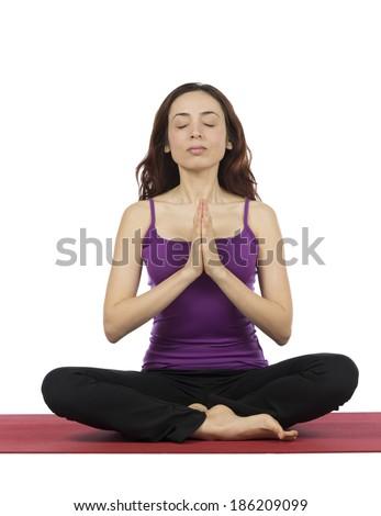 Young woman doing Namaste - stock photo