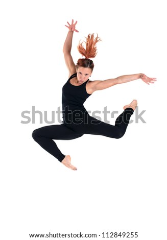 young woman doing perfect jump in black costume