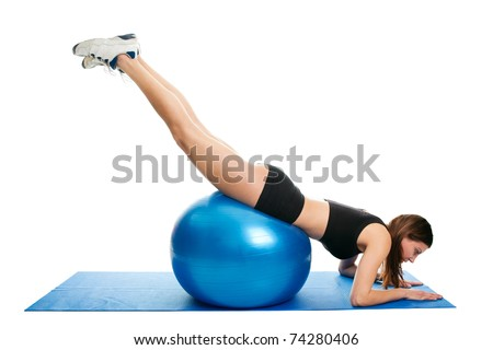Young woman doing roll-out on the fitness ball - stock photo