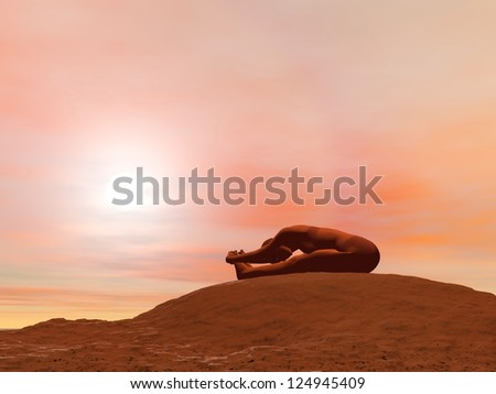 Young woman doing seated forward bend pose, paschimottanasana, while practicing yoga outside in front of sunset - stock photo