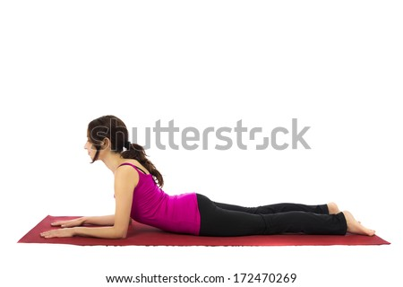 Young woman doing Sphinx Pose in Yoga (Series with the same model available