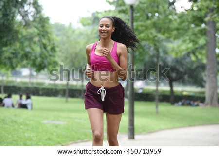 young woman doing sport in a park
