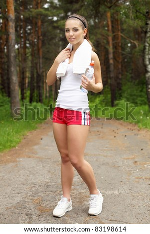 Young woman doing sport outdoors in summer - stock photo