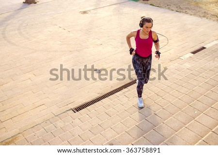 Young woman doing sport while climbing stairs - stock photo